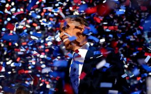President Barack Obama amidst confetti after giving his victory speech.